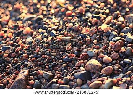 colorful pebbles pebbles on the beach - stock photo