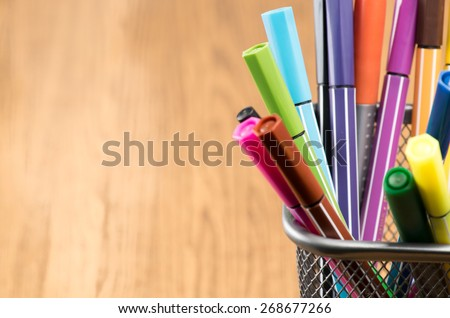 Colorful pen in metal pen pot - stock photo