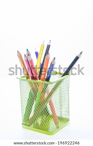 Colorful pencil holder isolated on white background - stock photo