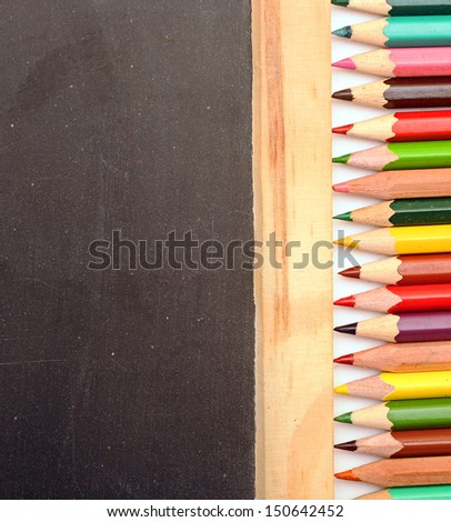 Colorful pencil on blank blackboard - stock photo