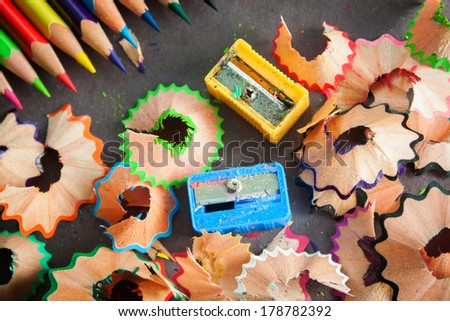 Colorful pencils and sharpeners with pencil trash - stock photo
