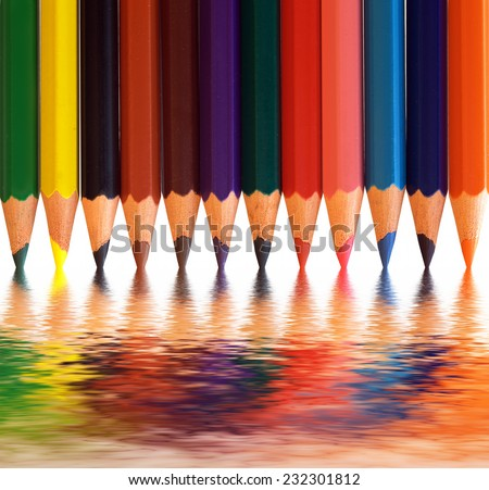 Colorful pencils arranged as a color pallete with abstract reflection. Concepts of creativity, art, school etc. - stock photo