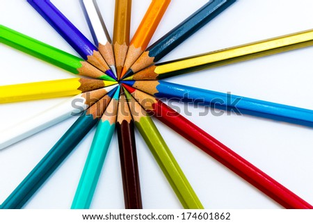 colorful pencils fanned on a white background - stock photo
