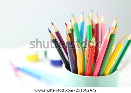 Colorful pencils in cup - stock photo