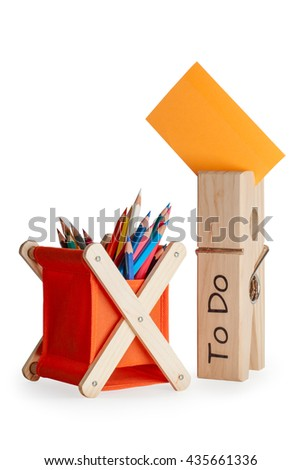 Colorful pencils in orange pencil case, big pin to do with orange notepaper on  white background. - stock photo