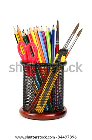 Colorful pencils in pencil cup isolated on white background, School supplies