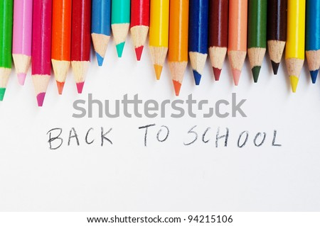 Colorful pencils on a white background, back to school - stock photo