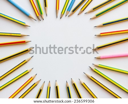 colorful pencils on the white paper, view from above. - stock photo