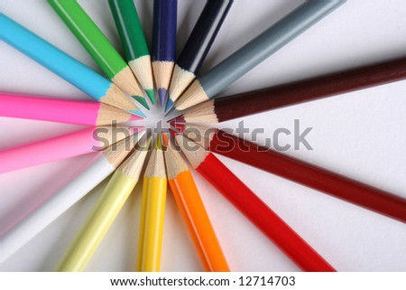 Colorful pencils over white background