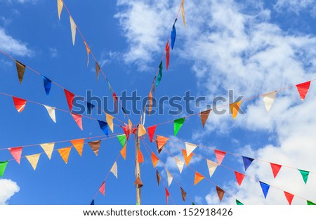 Colorful pennants with blue sky