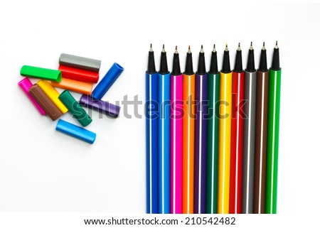 Colorful pens on white background - stock photo