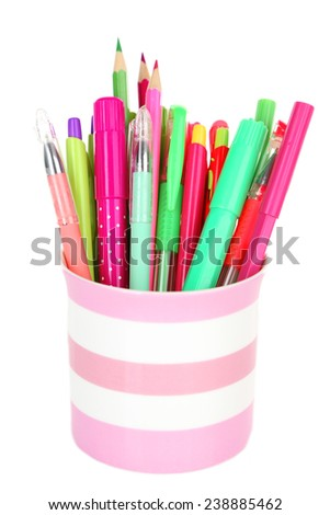 Colorful pens,pencils and markers in striped plastic cup isolated on white background - stock photo