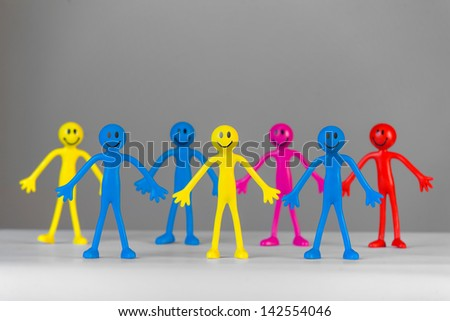 Colorful People on gray background. Concept - stock photo