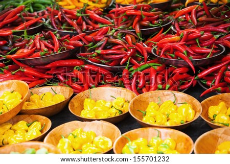 colorful peppers at a farmers market stall - stock photo