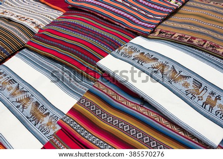 Colorful peruvian textile made of handicraft wool selling in market as souvenir for tourists - stock photo
