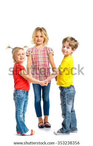 Colorful photo of little boy and cute little girls on white background. Children looking at camera and holding hands