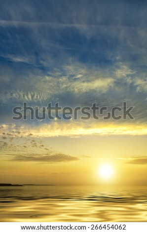 Colorful photo of tropical sunset with calm ocean - stock photo