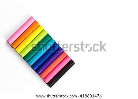 colorful piece set of modelling clay or plasticine with rainbow color for children play with they creativity, imagination and dream - stock photo