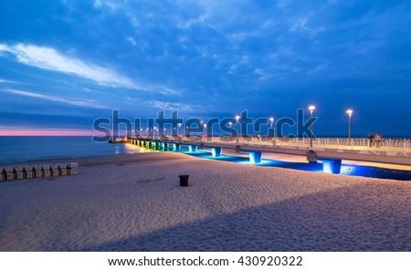 Colorful pier lights in the evening, Baltic Sea, Kolobrzeg, Poland - stock photo