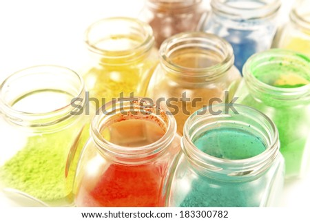 Colorful pigments in open glass jars