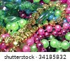 Colorful pile of Mardi Gras Beads - stock photo