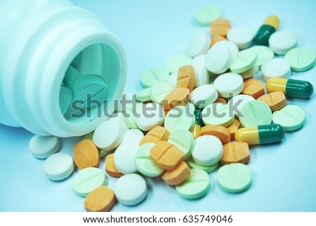 Colorful pill on white background.
