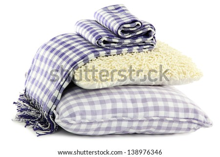 Colorful pillows and plaid isolated on white - stock photo