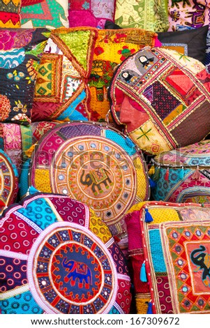 Colorful pillows at the market in India - stock photo