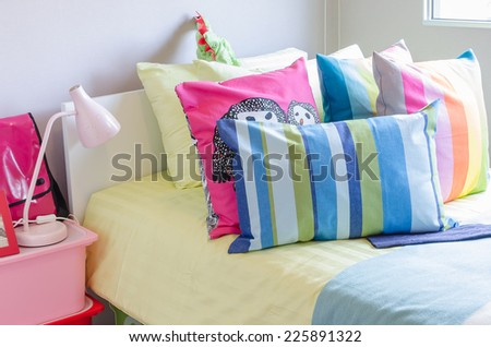 colorful pillows in kid's bedroom at home