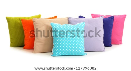 Colorful pillows isolated on white - stock photo