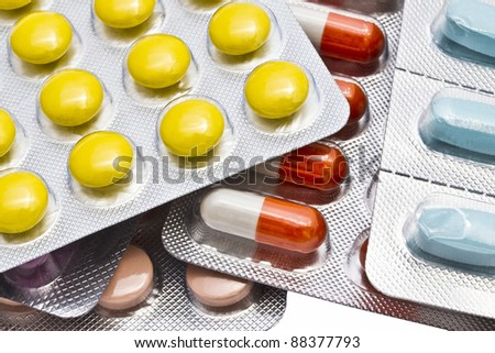 Colorful pills closeup on white background - stock photo