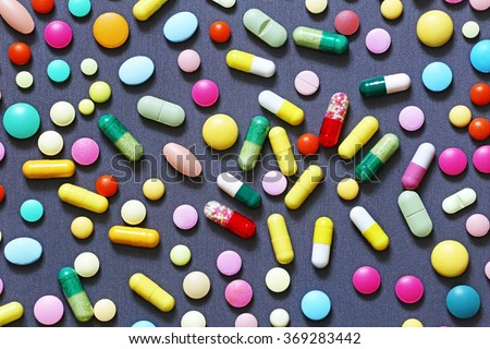Colorful pills on grey background - stock photo