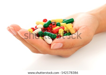 Colorful pills over white background. - stock photo