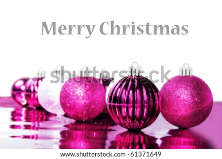 Colorful pink christmas baubles with space for text - stock photo