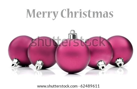 Colorful pink christmas decoration baubles on white with space for text - stock photo