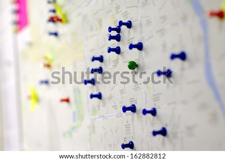 colorful pins on the map - stock photo