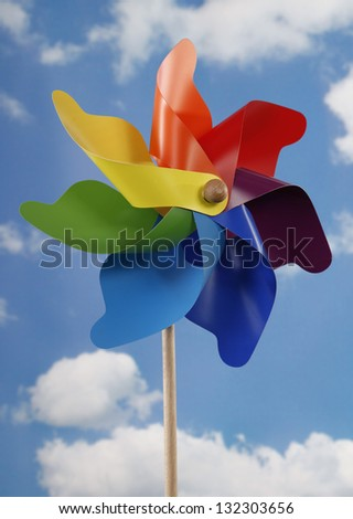 Colorful pinwheel toy and sky - stock photo