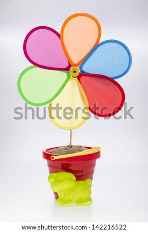colorful pinwheel with sand bucket - stock photo