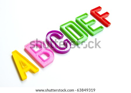 Colorful plastic alphabet, six letters A-F, isolated on white