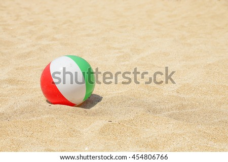 colorful plastic ball on the beach - stock photo