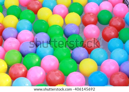 Colorful plastic balls floating on the water