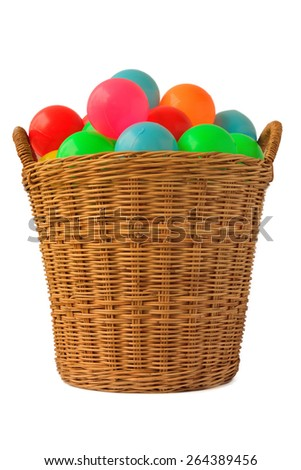 Colorful plastic balls in a basket with isolation background. - stock photo