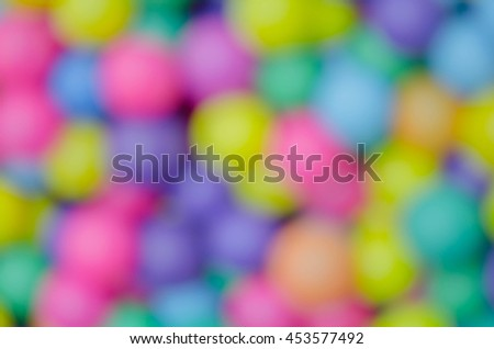 colorful plastic balls in children's playground pool. Intentionally blurred post production for soft focus image and pastel color.