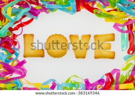 Colorful plastic band with cookie love text inside.
