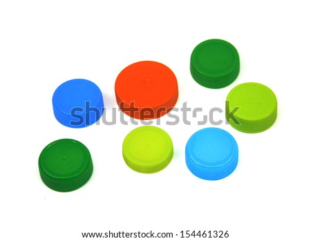 colorful plastic bottle caps isolated - stock photo