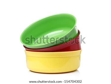 Colorful plastic bowls White background
