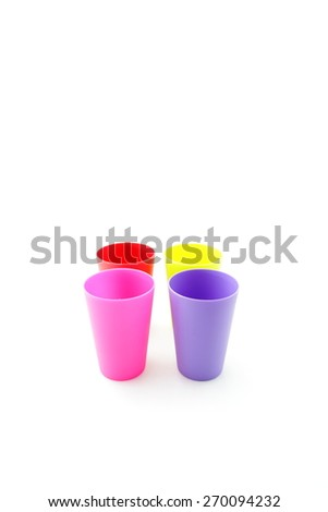 colorful plastic cup on white background - stock photo