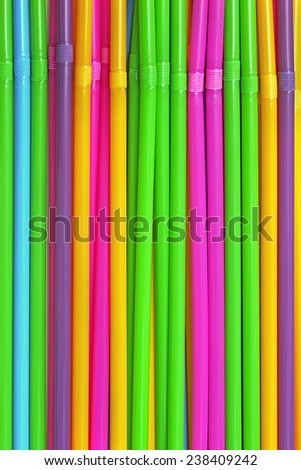 Colorful plastic drinking straws in a line