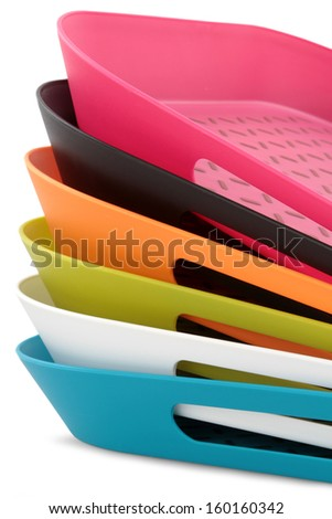 colorful plastic food trays on white Background  - stock photo