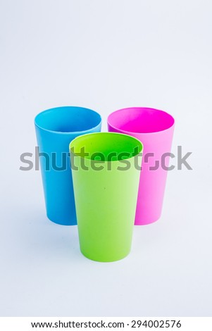 Colorful plastic glass isolated on white background - stock photo